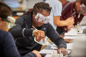 Students perform experiments in a chemistry lab at the Greater Hartford campus on Sept. 29, 2015. (Peter Morenus/UConn Photo)